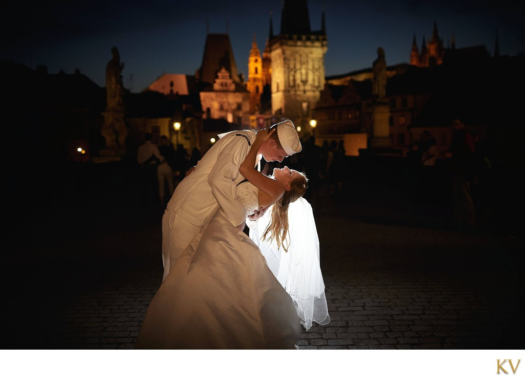 a kiss for his bride under the stars in Prague