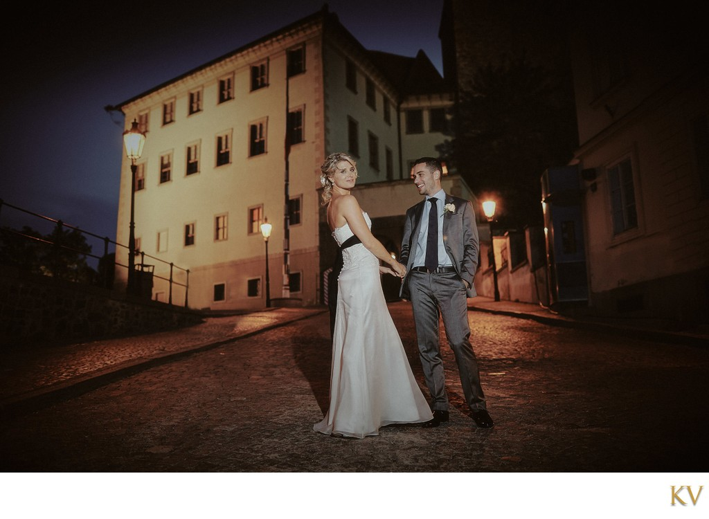 sexy newlyweds at Prague Castle at night