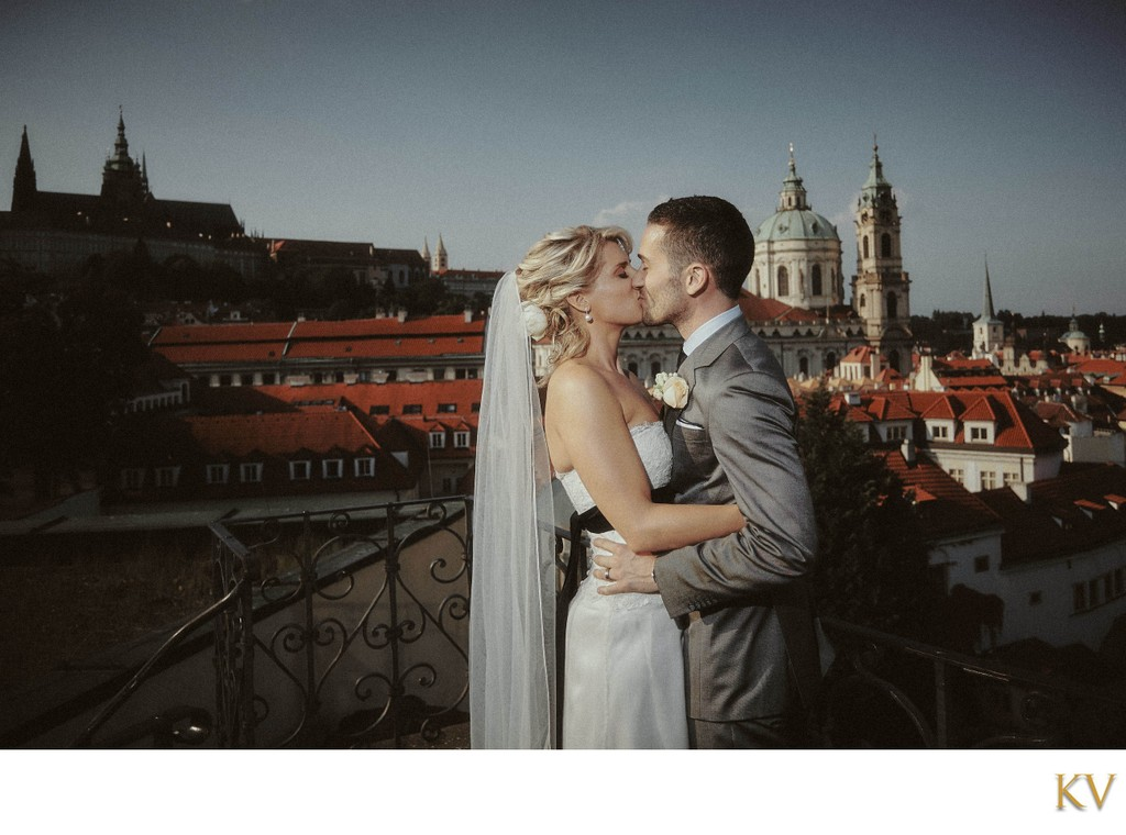 The newlyweds kiss atop the Vrtba Garden in Prague