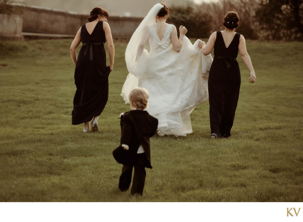 Page boy chases after the bride Carton House Ireland