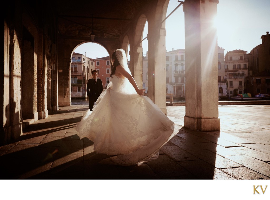 bride spinning in her wedding gown Venice, Italy