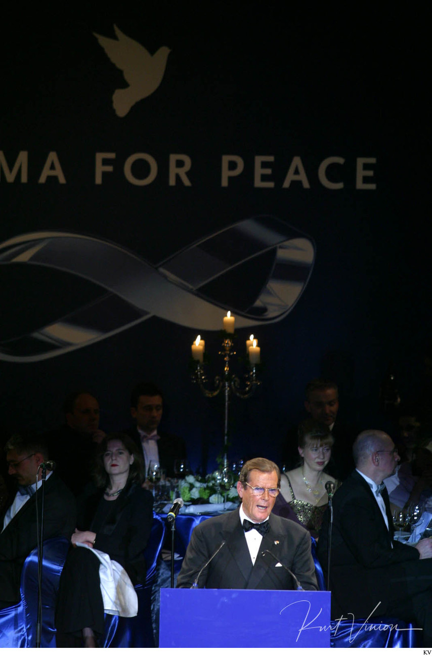 Roger Moore presents during the 'Cinema For Peace' gala