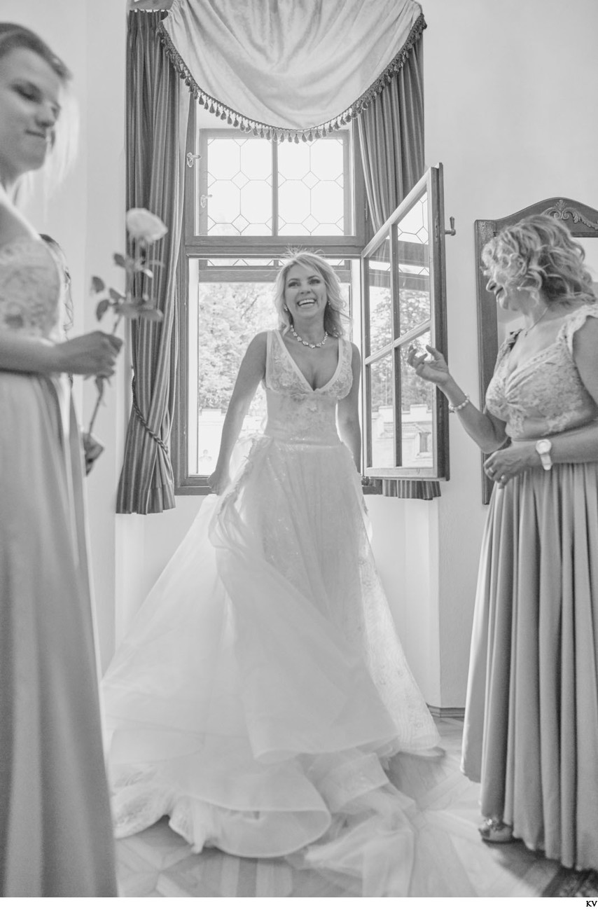 B&W portrait of the happy bride from her castle wedding