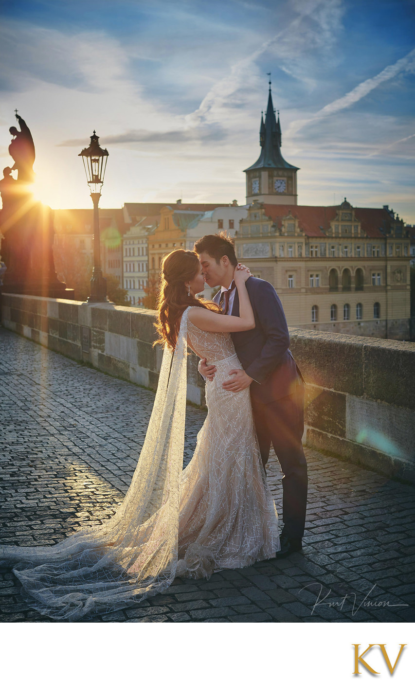 Gorgeous Hong Kong couple embracing at sunrise Prague