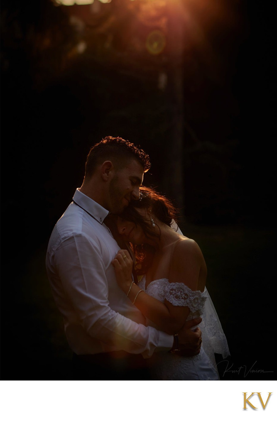 bride & groom enjoying fading sunlight secret garden