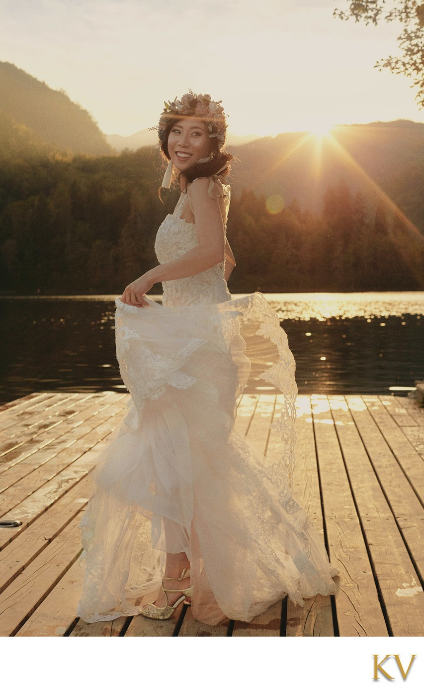 bride twirling her wedding dress Golden Light Lake Bled