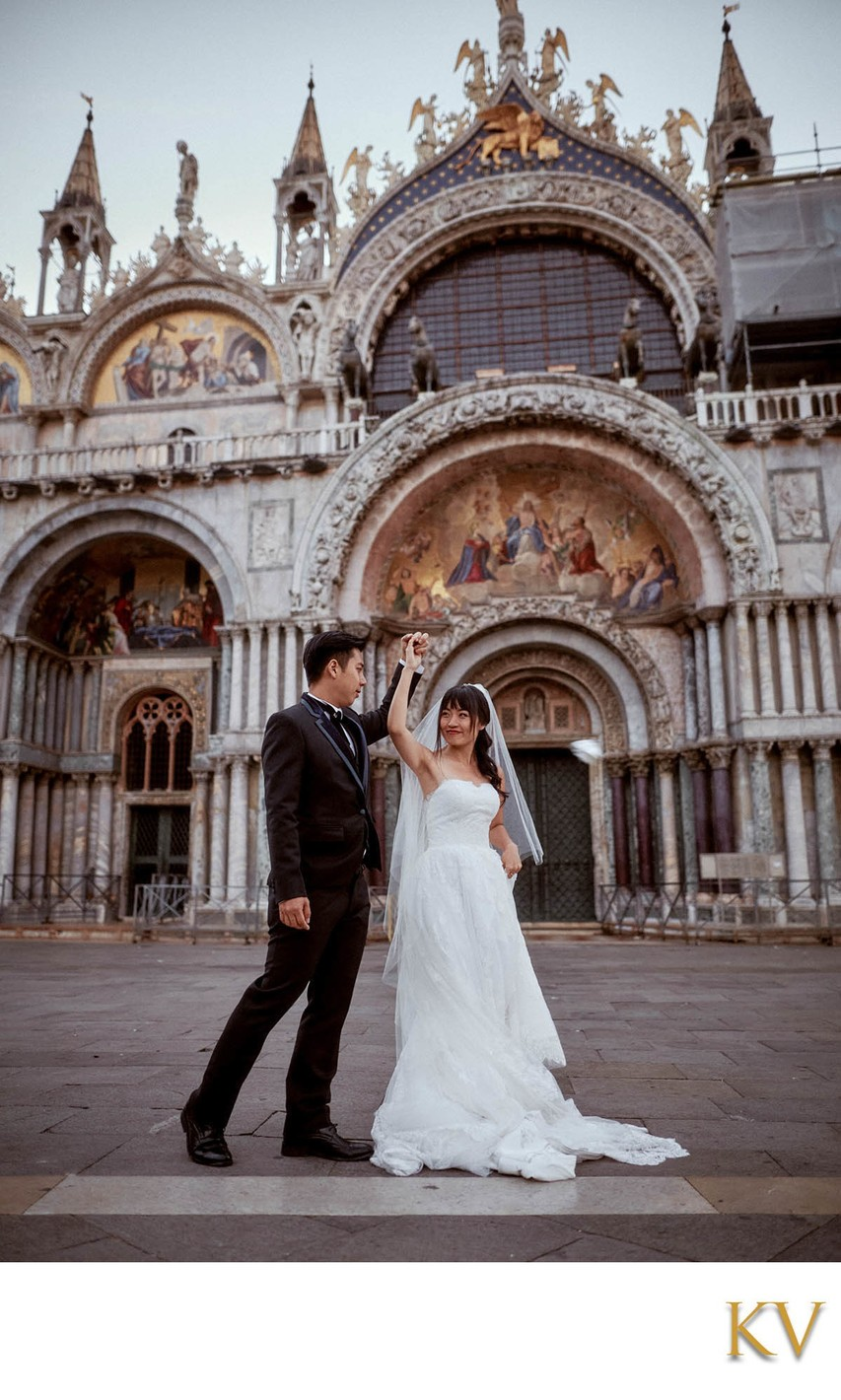 Twirling his bride in front of St Mark's Basilica Venice