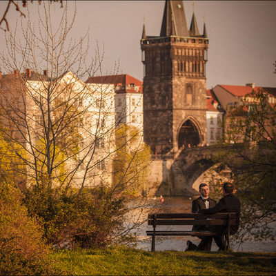 two men in love near the Charles Bridge in Prague