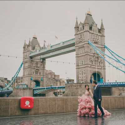 walking in the rain pink dress London Tower Bridge