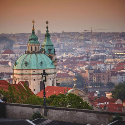 snuggling & looking over St. Nicholas Church in Prague