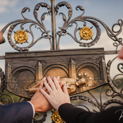 Making a wish on the Charles Bridge Engagement photo