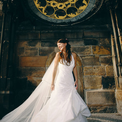 bride Ceceile under Astronomical Clock Prague wedding