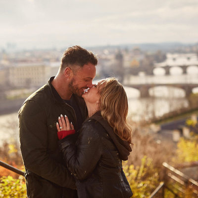 the happy newly engaged overlooking Prague