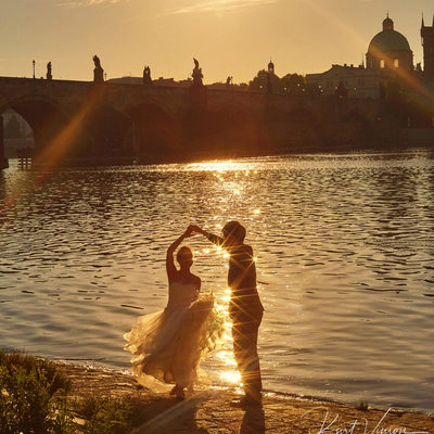 dancing in Golden Sunlight Charles Bridge wedded couple