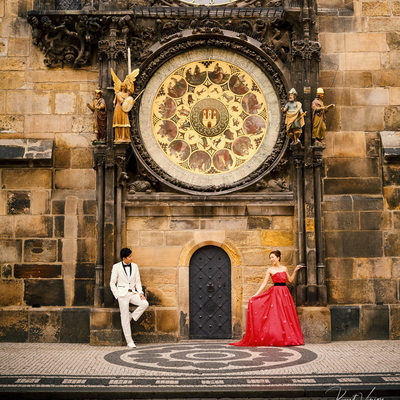 Bride-to-be Red Dress under Astronomical Clock Prague