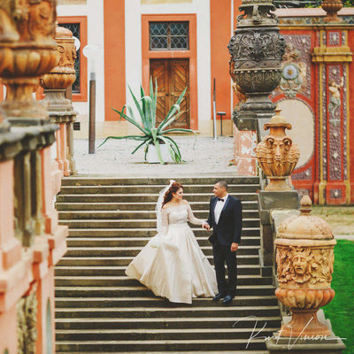 wedding couple walk around Prague Troja Chateau