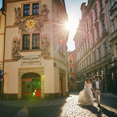 the sun flare leads the way to the Charles Bridge