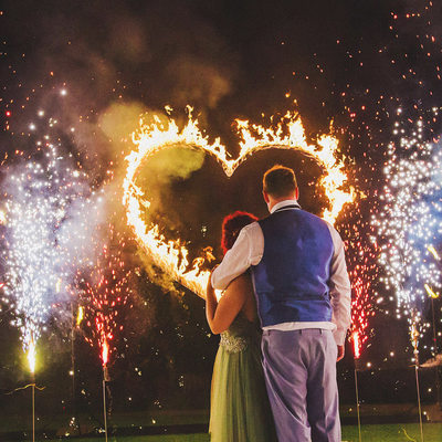 bride & groom watch a Fire Show at Chateau Mcely