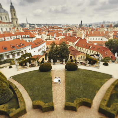 Twirling bride above Vrtba Garden Prague fine art photo