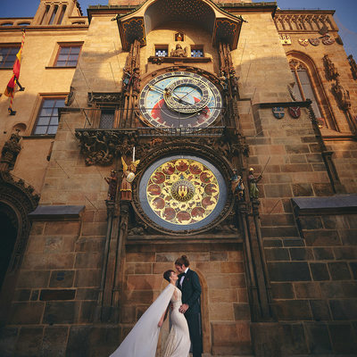 Bride in Berta dress underneath Astronomical Clock