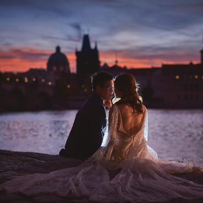 sunrise over the Charles Bridge engagement couple
