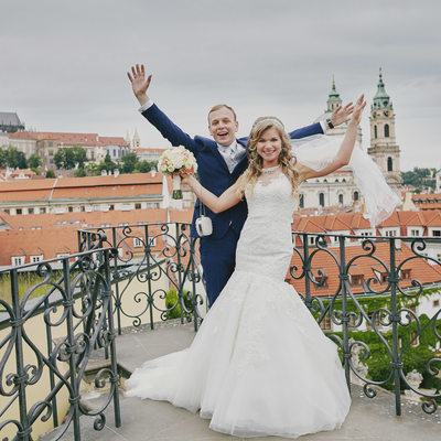 Happiest wedding couple atop Prague Vrtba Garden