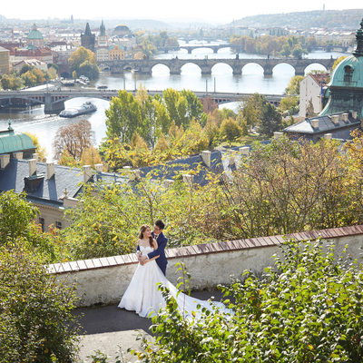 bride & Groom pictured above Prague with Vltava below