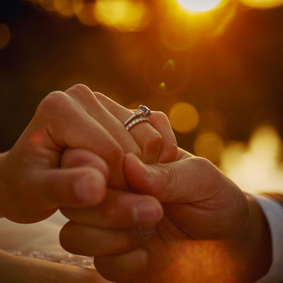 Bride & Grooms rings sunrise photo