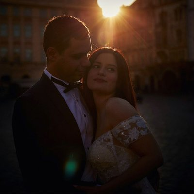 A portrait of the bride & groom Old Town Square sunrise
