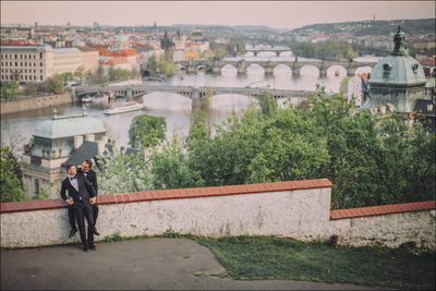 cuddling in their tuxedos overlooking Prague