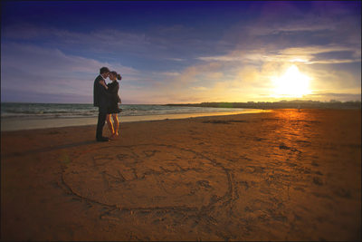 Brid & Nial beach engagement session names in sand