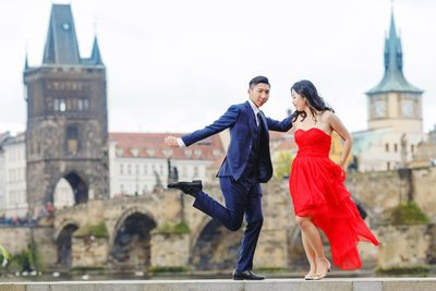 pre wedding photos Prague dancing near Charles Bridge