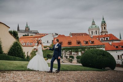 Bride & Groom walk with Prague Castle in background