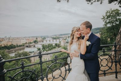 moment shared between bride & groom above Prague