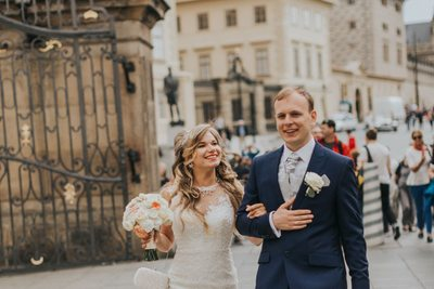 bride & groom walk near Prague Castle gates