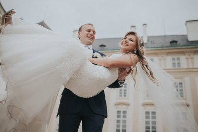 Spinning his bride at Prague Castle during wedding day