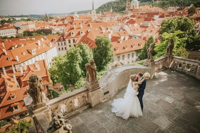 wedding couple embrace at Ledebour garden above Prague