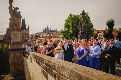 wedded couple and guests watch the balloons rise
