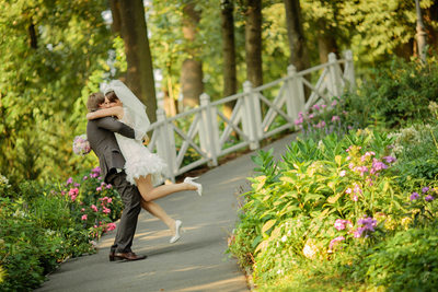 a kiss in the gardens Chateau Mcely summer wedding