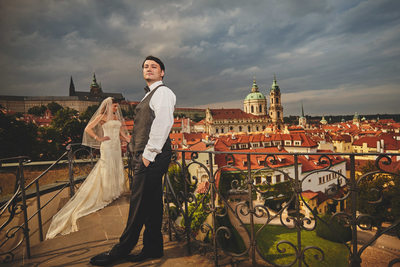 sexy wedding couple overlooking Vrtba Garden in Prague