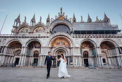 walking in front of St Mark's Basilica pre wedding