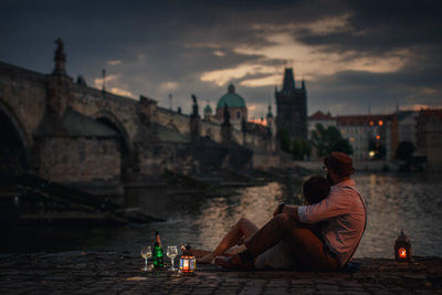 Watching sunrise over the Charles Bridge with Champagne