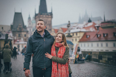 the newly engaged exploring the Charles Bridge