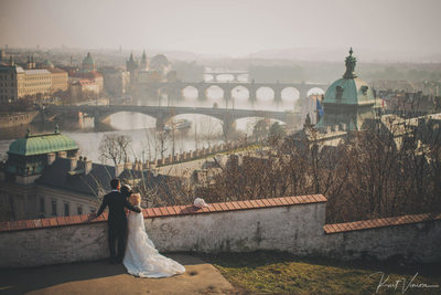 bride & groom enjoying the winter landscape of Prague