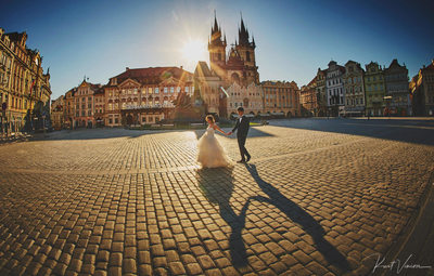 walking hand in hand Prague Old Town Golden Hour photo
