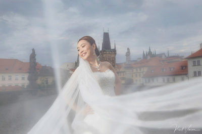 Hong Kong bride under veil Charles Bridge Prague
