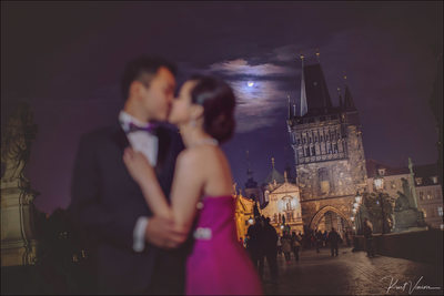 A super moon illuminates lovers on the Charles Bridge