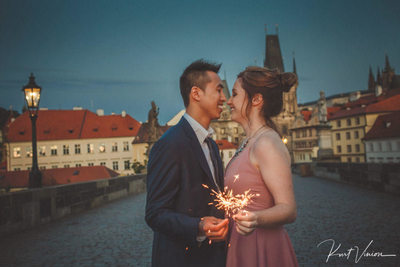 Couple with sparklers Charles Bridge twilight