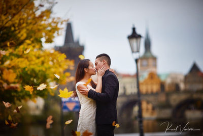 A Prague engagement photographed in Rain Charles Bridge
