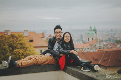 Wonderful photo of brother & sister overlooking Prague